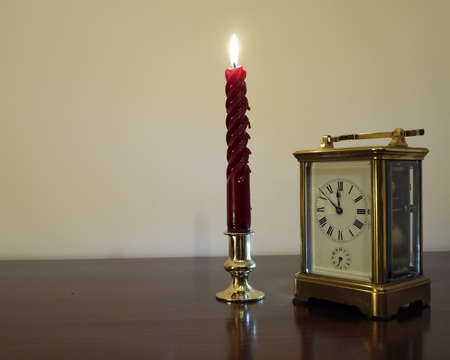 Candle & clock, minutes before twelve photo