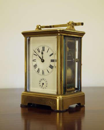 old bronze clock, minutes to twelve photo