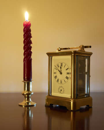 New Years Eve, old bronze clock and candle photo