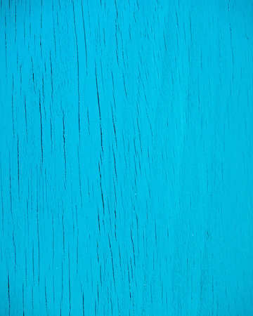 crack house: weathered blue painted wood background