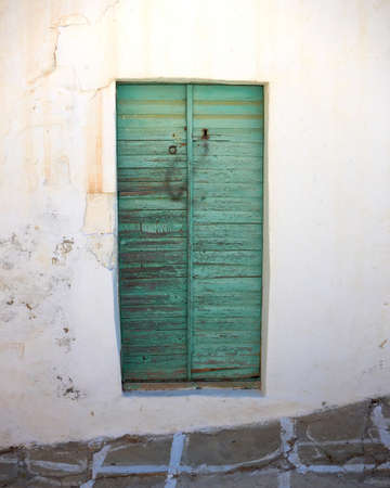 traditional Greek house green door Stock Photo - 10523177