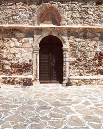 view of a wooden doorway: Greek byzantine church door