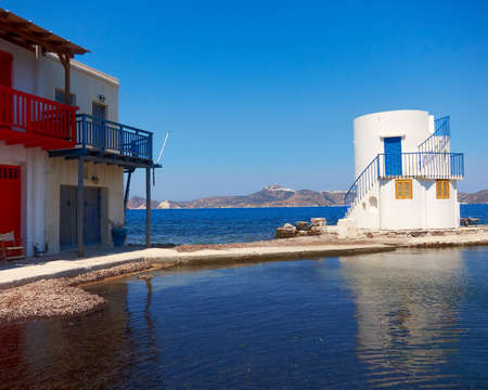 Fisherman s house and small lighthouse on Greek island photo