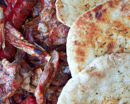 barbecue food and pita bread photo