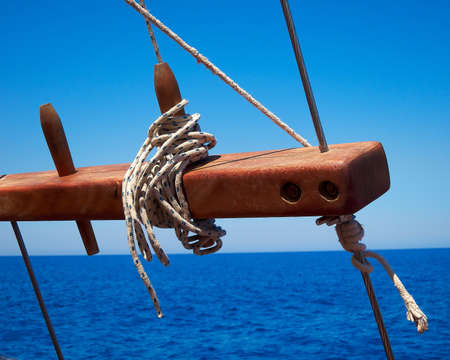 skiff: traditional yacht armament on nature s blue, sea and sky