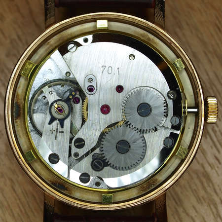 watch mechanism closeup photo