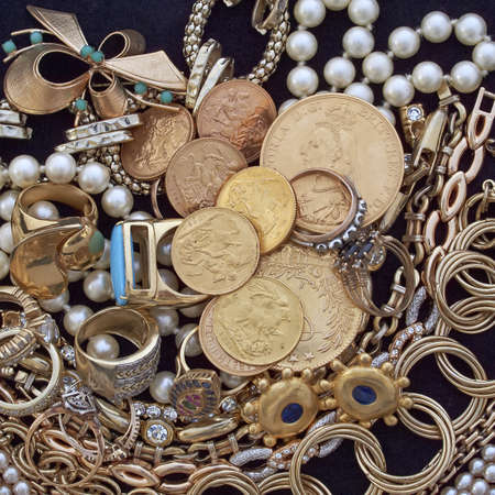 jewels and gold coins, vintage background Stock Photo