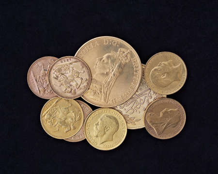 coins closeup, golden background photo