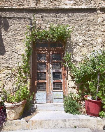 elegant house door and flowerpots, Athens Greece
