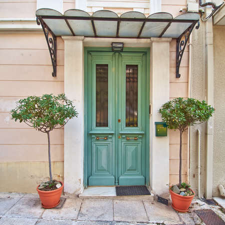 colorful house door and flowerpots, Athens Greece photo