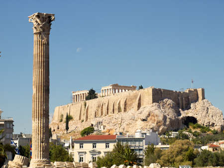 One column of Olympian Zeus temple, and Acropolis of Athens photo