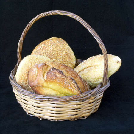 corn flour bread in a basket, black background photo