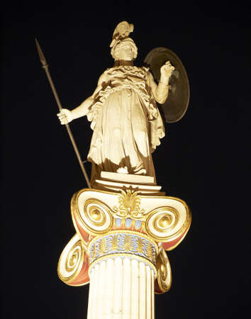 statue of Athena on a column at the Academy of Athens , Greece , night view photo