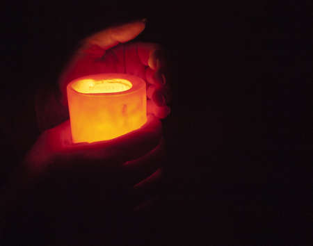 hands holding burning candle in the dark, room for type Stock Photo - 19931698