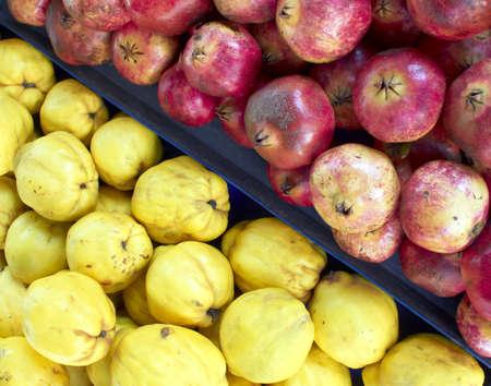 quinces: earth treasures, pomegranate and quinces closeup Stock Photo