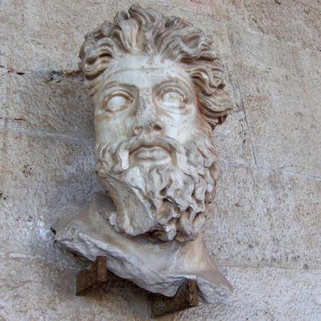 Triton head closeup, marine deity sculpture photo