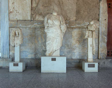Woman statue and two hermes servings, Attalus stoa, Athens Greece