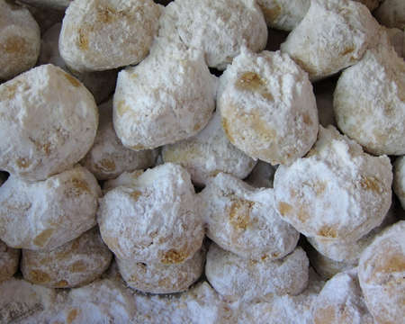 Kourabiedes, Greek christmas cookies, with butter and icing sugar photo