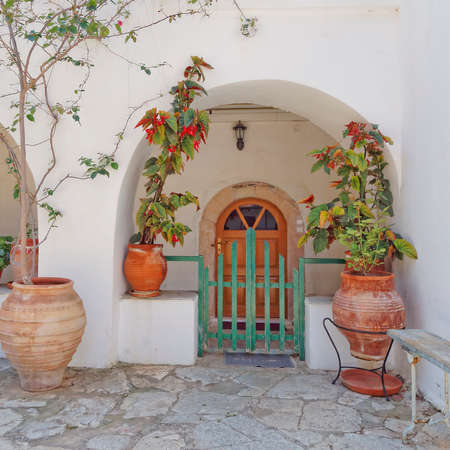 house door and flowerpots in a Mediterranean island photo