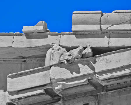 heads old building facade: Parthenon, ancient greek temple detail, horse head
