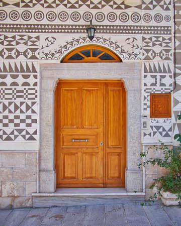 Ethnic style house entrance, Chios island, Greece photo