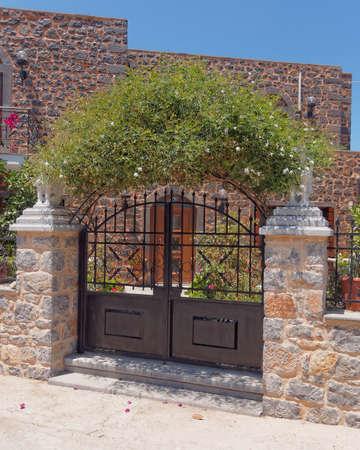 house entrance and jasmin plant arch Stock Photo