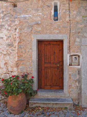 door and flowerpot, mediterranean island, Greece photo