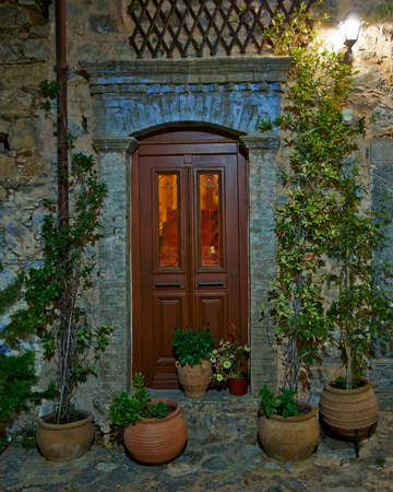 mediterranean house entrance, night at Chios island, Greece photo