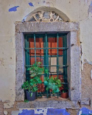 old window night view, Chios island, Greece photo