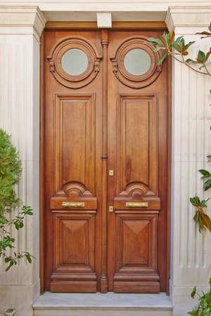 ox eye: elegant house double ox eye door, Athens Greece