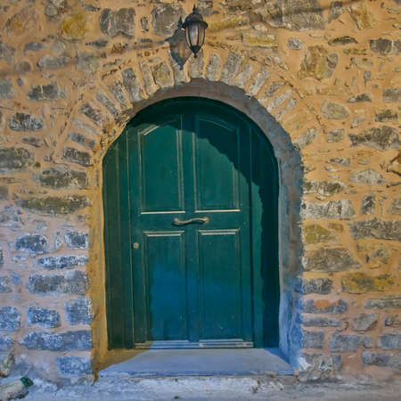green arched door, night view, Chios island, Greece