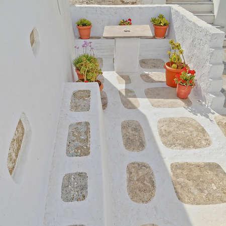 flowerpots in a white house yard, Greece photo