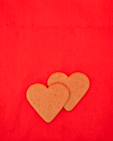 valentine background: a couple of homemade heart shaped cookies  Stock Photo