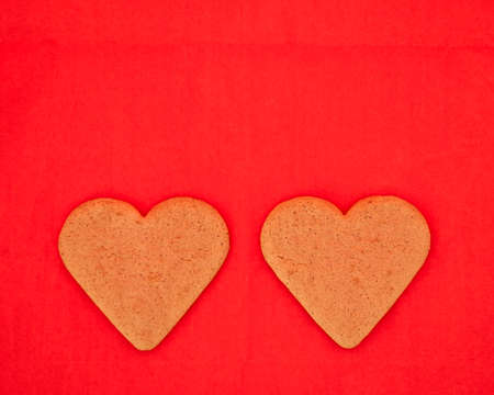a couple of homemade heart shaped cookies  photo