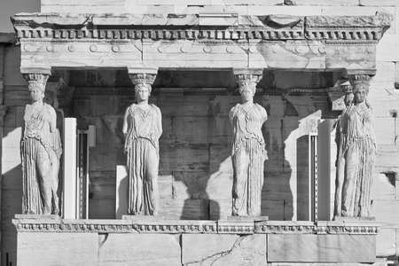 caryatids: Caryatids ancient statues in black and white, erechteion temple, Athens Greece Stock Photo