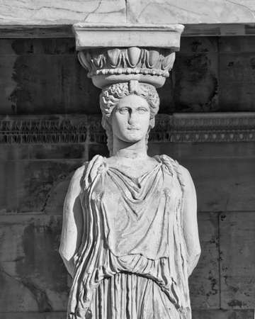 Caryatid ancient statue in black and white, erechteion temple, Athens Greece photo