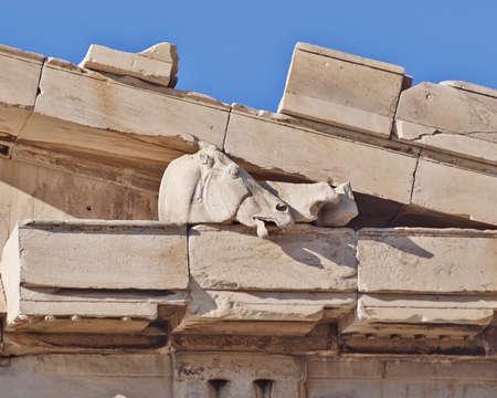 heads old building facade: Parthenon west pediment detail, horse head, Athens Greece