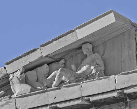 heads old building facade: Parthenon west pediment detail, horse heads and Dionysus (probably) layed, Athens Greece