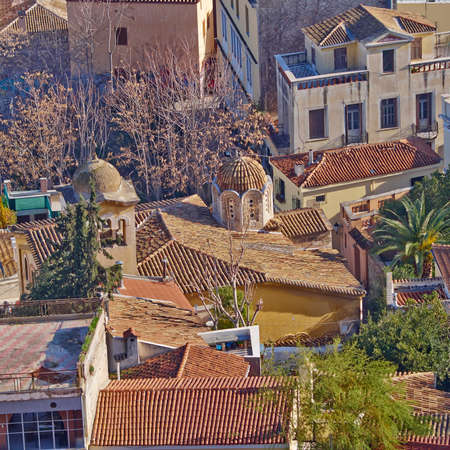 church domes and house roofs at Plaka, old Athens center under Acropolis,  Greece Stock Photo