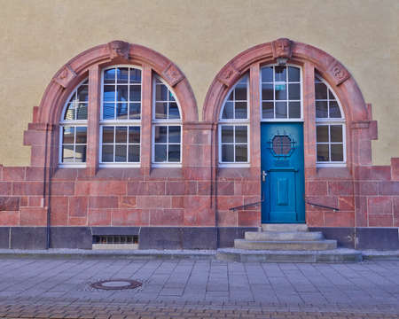 entrance with arched blue door and windows, central Europe photo