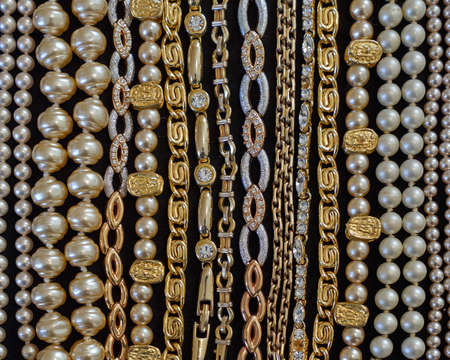 variety of golden jewelery closeup photo