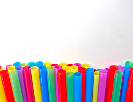 variety of drinking straws on white paper, space for typing photo