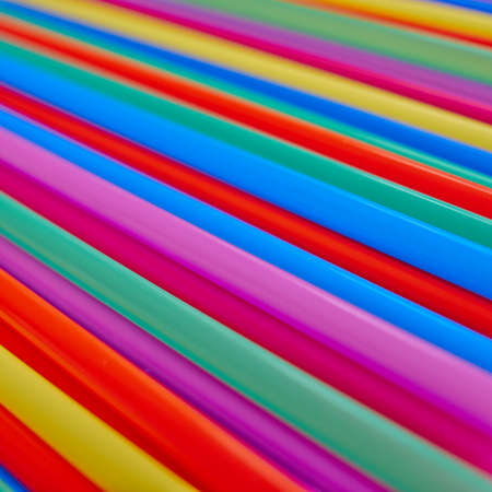 variety of drinking straws, colorful background photo