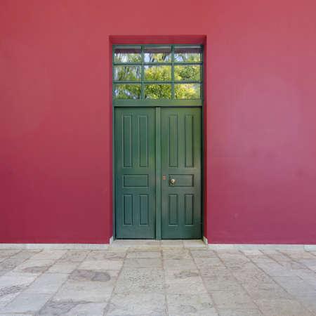 green door: colorful building detail, green door, red wall