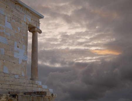 nike: Athena Nike ancient temple on Acropolis Greece, under a cloudy sky