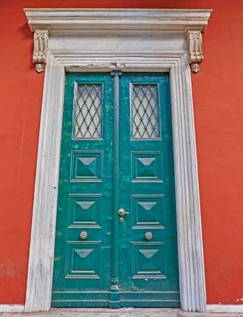 neoclassical: Athens, Greece, neoclassical green door Stock Photo