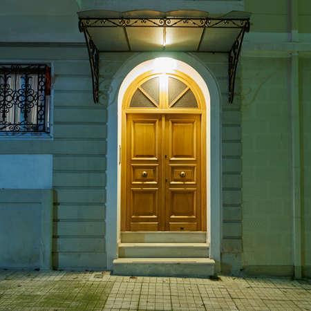 illuminated: illuminated house door, Athens Greece