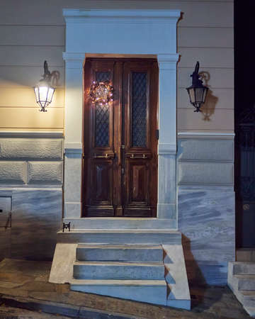 lighted house door Christmas decorated, Athens Greece Stock Photo