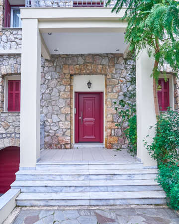 contemporary house red door, Athens Greece Stock Photo