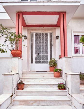 flowerpots: vintage house entrance and flowerpots, Athens Greece